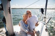Senior couple taking selfie on sail boat or yacht Stock Photos