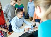 Students and teacher with tablet pc at school Stock Photos