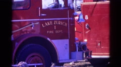 1968: a red fire engine with lake zurich printed on the side WAUCONDA, ILLINOIS Stock Footage