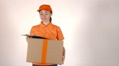 Girl courier in orange uniform delivering big cardboard parcel. 4K shot Stock Footage