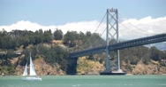 Yacht Sailing Under Bay Bridge, San Francisco Bay, California Stock Footage
