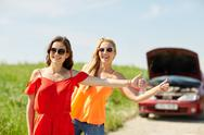 Women with broken car hitchhiking at countryside Stock Photos