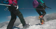 Two Mountaineers crossing Snow Filed on Glacier. Stock Footage