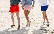 Close up of women legs running on beach Stock Photos