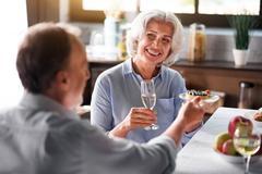 Grandpa offers cake to nice smiley grandma Stock Photos