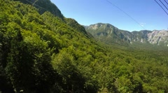 Ropeway cable car ride, side window view of the forest Stock Footage