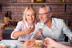 While heterosexual couple tasting wine at restaurant Stock Photos
