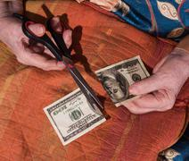 Woman holding torned one hundred dollar bill Stock Photos