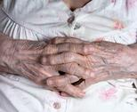 Old wrinkled woman's hands Stock Photos