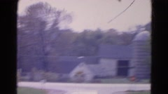 1968: old fashioned hose near to a road where cars moving WAUCONDA, ILLINOIS Stock Footage