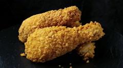 Breaded crispy chicken leg fried Stock Footage