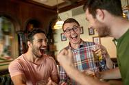 Football fans or friends with beer at sport bar Stock Photos