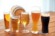 Close up of different beers in glasses on table Stock Photos