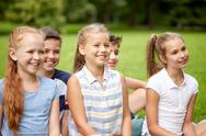 Group of happy kids or friends outdoors Stock Photos