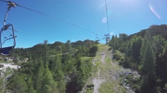 Chairlift cable hoist ride on bright summer day Stock Footage