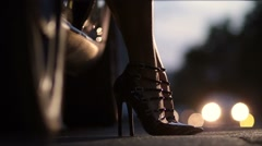 Woman's leg in high heel shoes getting out of car Stock Footage