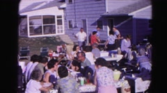 1962: a large number of people gather on a clear sunny day on benches  Stock Footage