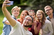Friends taking selfie by smartphone at summer Stock Photos