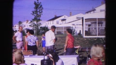 1962: people outside having a large family picnic with the kids HAGERSTOWN Stock Footage