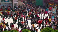 CROWDS PEOPLE COBBLED R DE SAO PAULO MACAU CHINA Stock Footage