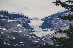 Avalanche on rough rocky mountains Stock Photos