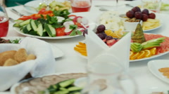 Table with food and drink Stock Footage