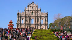 CROWD TOURISTS RUINS ST. PAULS CHURCH MACAU CHINA Stock Footage