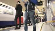 London Underground: Tube passengers on the platform of Leicester Square station. Stock Footage