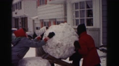 1962: a snowman is seen build HAGERSTOWN, MARYLAND Stock Footage