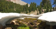 Ice & Snow Melting at Base of Mt Lassen, Lassen Volcanic National Park 2 Stock Footage