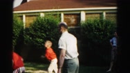 1962: a father is seen playing with children HAGERSTOWN, MARYLAND Stock Footage