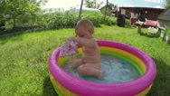 Little girl have fun swim in swimming pool on the summer Stock Footage