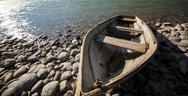 Boat near mountain river Stock Photos