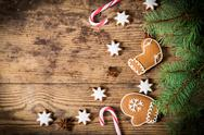 Wooden christmas background with gingerbread cookies Stock Photos