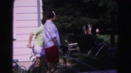 1962: two women outside with a shuffleboard sticks in their hands as they play Stock Footage