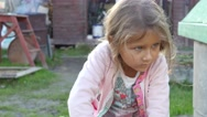 Little girl is playing with a hammer and nails Stock Footage