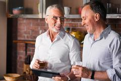 Two gentlemen having a little party with alcohol Stock Photos