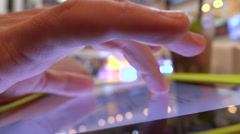 Hand gestures over tablet PC in a cafe. Bokeh background 4K shot Stock Footage