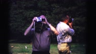 1962: two men standing outside each taking pictures with a camera HAGERSTOWN Stock Footage