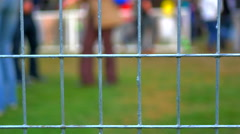 4K Mesh Wire Fence at Music Festival Concert, Crowd Background Stock Footage