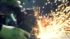 Close-up of worker cutting metal with grinder. Sparks while grinding iron. Low Stock Footage