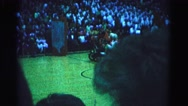 1962: people in costumes riding a go-kart across a basketball court  Stock Footage