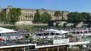 Paris, France. Long pleasure boat full of people on the River Seine. Stock Footage