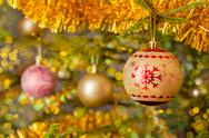 Decoration bauble on decorated Christmas tree background Stock Photos