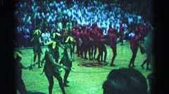 1962: kids in costume performing on a basketball court in front of an audience Stock Footage