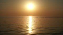 Seaside resort. Sunset. Calm sea in the light of setting sun. Wide angle. HD Stock Footage