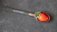 Healthy food text, spoon and strawberry on vintage table Stock Footage