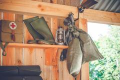 Retro survival kit in a wooden cabin Stock Photos