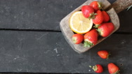 Food background. Ripe sweet strawberries on wooden table Stock Footage