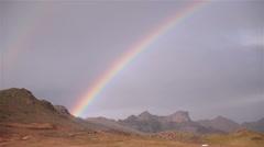 Bright rainbow over mountains Krysuvik Iceland Stock Footage